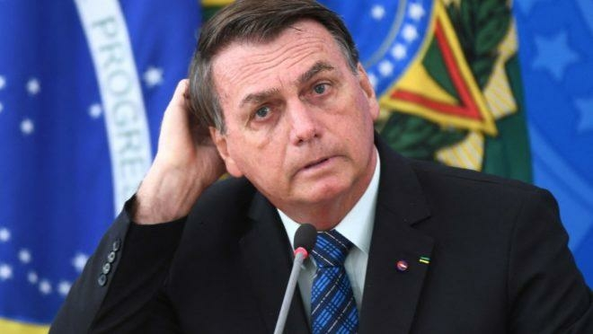 Brazilian President Jair Bolsonaro gestures as he speaks during a press conference on a new fuel tax policy at Planalto Palace in Brasilia on February 5, 2021. (Photo by EVARISTO SA / AFP)